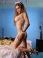Busty transsexual maid shows her huge cock